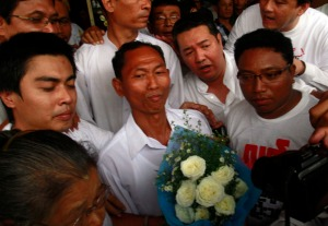 Political prisoner Ko Ko Gyi (center) as he is released in Yangon on January 13, 2012.
