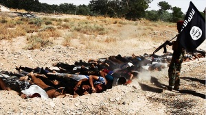 An image uploaded on June 14, 2014 on the jihadist website Welayat Salahuddin allegedly shows militants of ISIS executing dozens of captured Iraqi security forces members at an unknown location in the Salaheddin province.